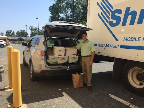 A Delivery of Documents for C21 Redwood Montclair Office's Shred it Event